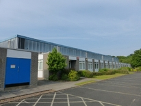 INDUSTRIAL PREMISES AND SITE FOR SALE